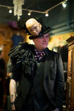 doll face hat and ruffled men's jacket