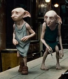 Dobby and Kreacher.I was really angry when they didn't show the scene that happens at the end of the book with Kreacher proudly leading all the House Elves in the Hogwarts kitchens to help in the battle. Dobby Harry Potter, Harry Potter World, Theme Harry Potter, Mundo Harry Potter, Harry Potter Wizard, Harry Potter Love, Harry Potter Universal, Harry Potter Characters, Kreacher Harry Potter