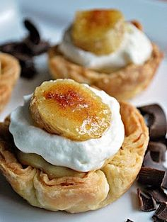 Mini Banana Cream Pies    2 cups whole milk  6 large egg yolks  1/2 cup (packed) light brown sugar, pressed through a sieve  1/3 cup cornstarch, sifted  1/2 teaspoon ground cinnamon  1/8 teaspoon freshly grated nutmeg  pinch of salt  1 teaspoon pure vanilla extract  3 tablespoons cold, unsalted butter, cut into bits  3 ripe but firm bananas, sliced    To make the custard, bring the milk to a boil.