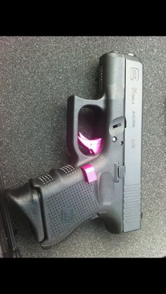 This is my Glock 26 gen 4! Added pink trigger and pink mag release! #glockgirl #dontmess #withlisa :)