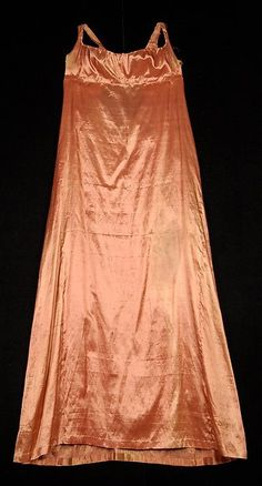 Silk underdress from 1805-1810. I love the apricot color. Almost looks like a modern nightgown, doesn't it? But this would have been worn beneath a sheer overdress, probably with embroidery and detail.
