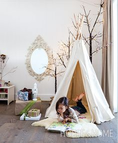A teepee is a kid-friendly but super-stylish addition to a living area, especially when it comes with a faux sheepskin for warmth and comfort. | Photographer: Donna Griffith Designer: Grace Castaneda