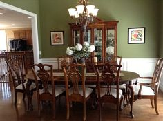 Wow, a green dining room with very white trim.  Is that light kitchen cabinets in the background?  Also, like the artwork.  1019 Bent Pine Court in Maple Ridge.