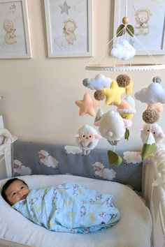Handmade felt baby mobile with lambs, mountains, moon and stars. ▪️▪️▪️ Cute lambs are twirling joyfully among the green meadows and mountains. This mobile will become your baby's first exciting journey!