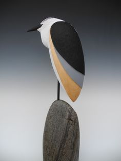 Heron.....  Carved pine on stone base.  20' tall.  Oil finish.  www.tjmcdermott.com
