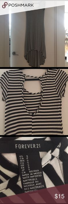 Black and white stripped cotton summer dress small Worn once. From Forever 21.  Cute bland and white stripped dress. Light airy cotton material. High to low hem. Cute peep hole in the back. Size small. Forever 21 Dresses High Low
