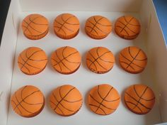 Basketball cupcakes that were ordered as gift to be given out to a young basketball team along with their medals when they broke up for the ...