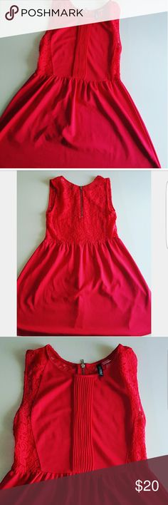 Divide H&M Spring Dress Fushia knee length spring/summer dress Has lace in the back front half  and side with zipper Neck line jewel type Very comfy with  stretchy material at the bottom,  and front bust area. Gently pre- owned H&M Dresses