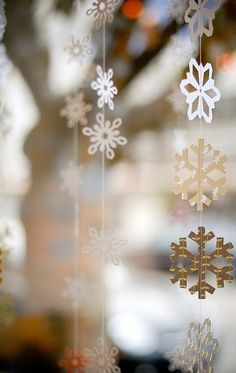 Snowflakes....we did something similar in our window....only ours are glittery...and blue & white. #lulusholiday