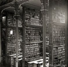 Iconic Historical Photographs From United States. A man taking a book off the shelf in Cincinnati, Ohio, main library in Photo by: Public Library of Cincinnati and Hamilton County.