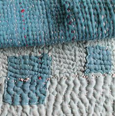 Beautifully rustic, simple quilt with Kantha style stitching