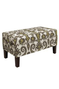 Ikat storage bench- a great place to keep the blankets. #storage #ikat