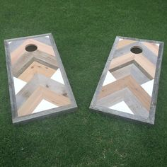 Cornhole Set includes: - (2) Regulation size boards with JLW style wood art detail playing surfaces - (8) duck canvas bean bags (4 white, 4 gray) - Folding legs for easy storage All boards are backed