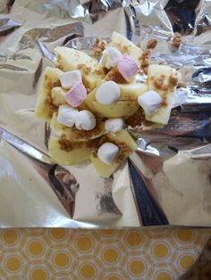 campfire dessert pocket. Peeled and sliced apples, brown sugar, marshmallows and cinnamon. Cook over coals till apples are soft.