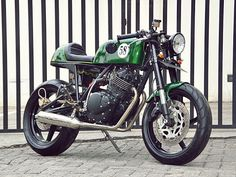 "Racing Cafè: Suzuki Thunder 250 ""Simoncelli Tribute"" by Studio Motor.  This could be one of the best 250s around. I like the exhaust, but enough ground clearance?"