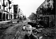 An orphan boy in the street. Ulikemina (Street of Peace). Grozny.    1996    Christopher Morris. #christophermorris  http://www.widewalls.ch/artist/christopher-morris/