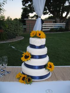 Cake with sunflowers and navy ribbon