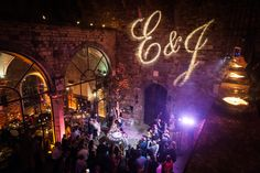 Esin & Jon - ALMA PROJECT @ Castello di Vincigliata - Courtyard Party Lighting and Deejay Set - Initials  Projection - Courtyard