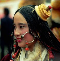 Khampa Tibetan lady with traditional Tibetan jewelry