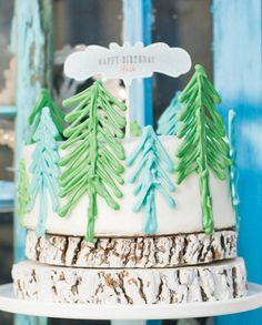 Whimsical Winter Wonderland Dessert Table Cake. I like the trees and the tree trunk bases.