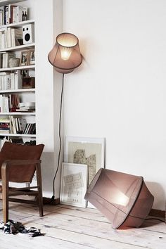 Interesting lamps, wide plank floor.