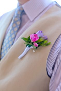 Freesia boutonniere for Neil would look nice also - light or white freesia