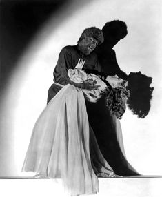 With Lon Chaney Jr. in a promotional still for THE WOLF MAN (1941).