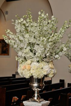 I imported Dutch Delphinium for the ceremony along with arctic white hydrangea, designed in our sterling silver magnum champagne buckets they set the stage for Amanda and her Dad's walk down the Aisle