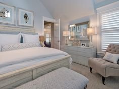 Soft shades of light blue and gray makes this guest bedroom feel inviting and quiet.
