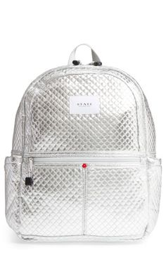 Free shipping and returns on STATE Bags Quilted Metallic Kane Backpack at Nordstrom.com. Uptown or down, this quilted silver bag is packed with street style to spare. Plenty of pockets and padded shoulder straps make it as user-friendly as it is fashionable, and with STATE Bags' #GiveBackPack program, you'll feel as good as you look.