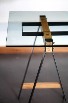 "The Glass Trestle table ""explores the relationship between steel and wood to complement each other in a way that each material is intrinsically weak without the other,"" Pedersen says. ""The wood is clamped between the steel, which in turn holds the structural steel that supports the weight of the glass as it spans. The manufacturing process interests us a lot as the parts are individually cut out and welded together, but the strength only comes when the parts are assembled. We've done a range…"