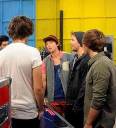 So I see this picture of Emblem 3, and then i notice harry...and look how tall he is. Stop growing. Just stop
