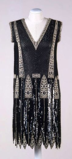 Evening dress, Sartoria Buscaroli, Bologna, ca. 1925. Black silk chiffon with narrow pointed panels. Embroidered with glass beads and sequins. Photo: Paolo Bacherini, Susanna Sordi, Roberto Serafini. Collection Galleria del Costume di Palazzo Pitti via Europeana Fashions