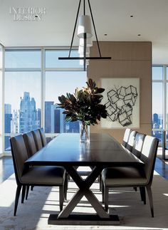 [The+dining+area+centers+on+Christian+Liaigre's+table,+complemented+by+leather-upholstered+chairs,+a+bronze+chandelier,+and+a+custom+wool+rug.+The+print+is+by+Mel+Bochner.jpg]