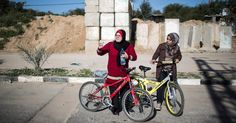 Four women are the first in years to pedal publicly in Gaza, where Hamas has restricted women's sports, and they have drawn scorn from conservative Palestinians.