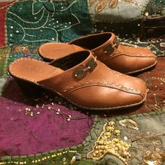 Boutique Leather Mules Light Brown Leather upper embellished with contrast stitching and medallions.  They are in excellent condition.  Minor wear on the heels and insoles. Shoes Mules & Clogs
