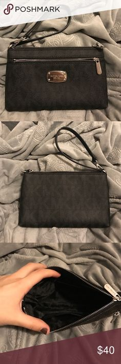 Michael kors wristlet used maybe 2 times. it's a very good size, can fit a lot of stuff in the bigger part and there's also a second zipper! couple scratches on the metal plate on the front, but other than that it is in perfect condition! Michael Kors Bags Clutches & Wristlets