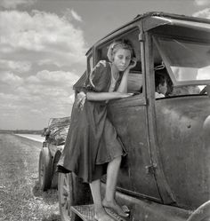 """1937. """"Child of Texas migrant family who follow the cotton crop from Corpus Christi to the Panhandle."""" Photo by Dorothea Lange"""