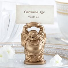 These golden buddha place card holders make the perfect wedding favor!