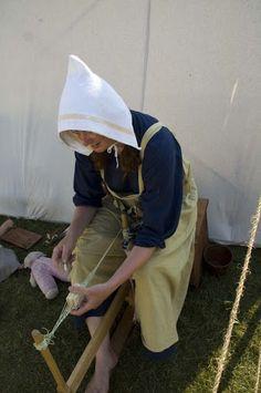 Viking reenactor tablet weaving at Gimli in 2010.                                                                   Like her cap pinning for Head Games