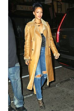 Wearing a shearling coat with a slinky black tank, distressed jeans and lace booties for an evening out in New York City.