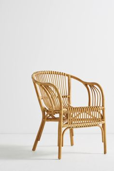 Formed from naturally durable rattan reeds, this curving chair nods to British colonial furniture, providing a sturdy addition to your living space that doesn't. Sofa Rattan, Rattan Furniture, Outdoor Furniture, Rattan Stool, Woven Chair, Ikea Wicker Chair, Porch Furniture, Pipe Furniture, Upholstered Chairs