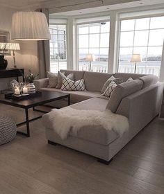 Neutral Living Room Inspiration | Grey Sectional | Hardwood Floors | Large Windows | Modern Black Coffee Table