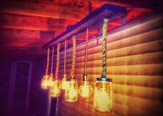 Pendant Lighting Edison Mixed Bulbs and Mason Jars hanging from Timber Panel!