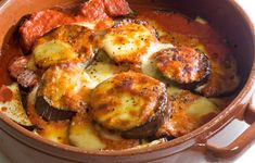 Aubergine Parmigano This is a firm family favourite, a comfort food that I serve with crusty bread and a green salad on cold days. Very easy to make -  you just layer the aubergines, mozzarella, tomato and parmesan and cook it until it all melts.  It's also great for dinner parties and easy weekend lunches.  Children will enjoy salting and weighing down the aubergines, ripping up the basil and tearing the mozzarella.