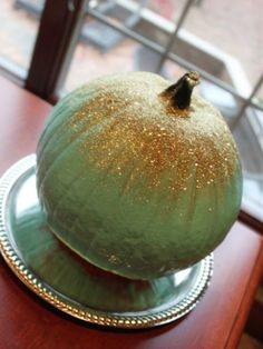 Add a glam touch to your pumpkin with this glitter tutorial.