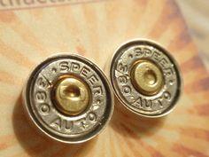 bullet casing earrings.