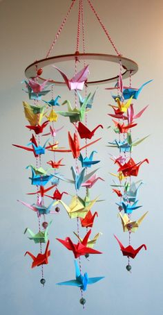 These cranes were hand-made by me (and differences are expected). Every crane is completely unique, made only from recycled, repurposed paper, which I have individually selected and hand cut. It's like a treasure hunt for me Origami cranes represent good luck, happiness and love. For an art th...