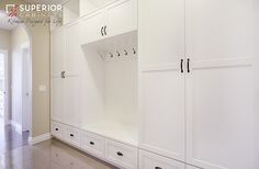 Great design by Superior Cabinets that allows the coats and backpacks to remain in plain view, while neatly storing everything else behind doors and drawers.