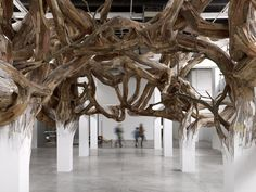 In this incredible installation by Henrique Oliveira we see architectural beams and columns morph into tree branches....